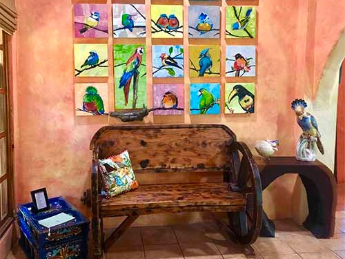 Room With Wooden Bench and Bird Paintings